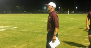 Oak Hall coach watches game