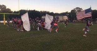football team runs onto field