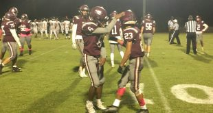 Oak Hall player celebrates with teammate