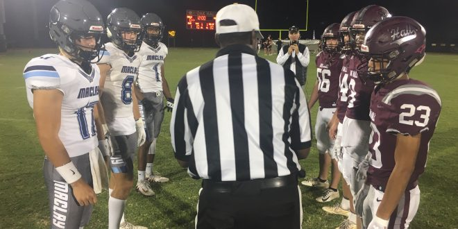 Maclay and Oak Hall captains line up for coin toss prior to game