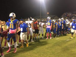 Newberry and Fort White shake hands after 2OT win for the Panthers.