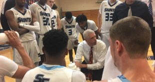 Chris Mowry leads huddle during timeout
