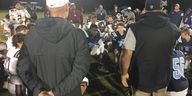 Oak Hall and Foundation Academy coaches talk to players
