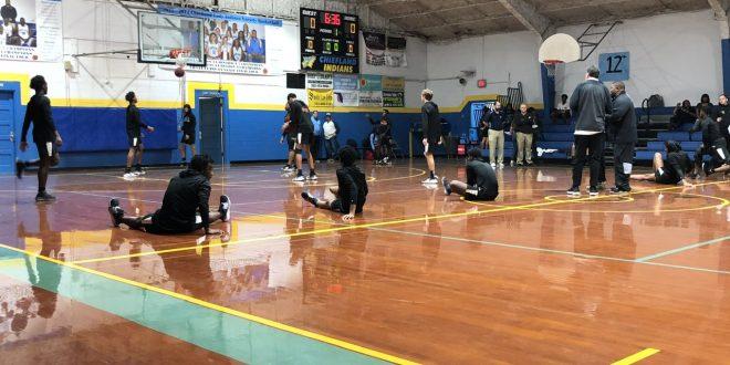 Hawthorne basketball team stretches pre-game