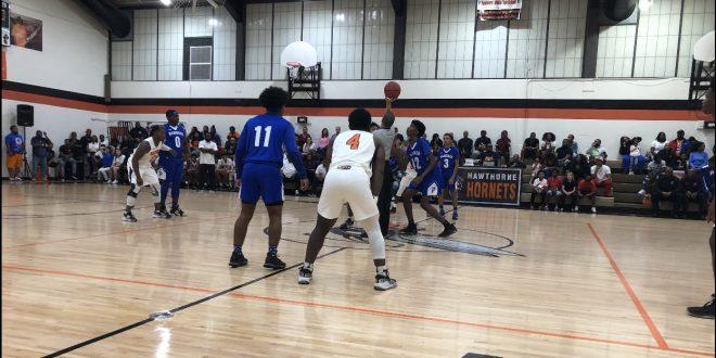 Jump ball at Hawthorne boys' basketball game