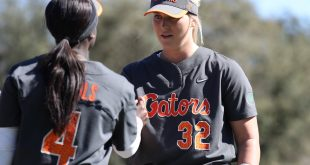 Gator softball players shake hands