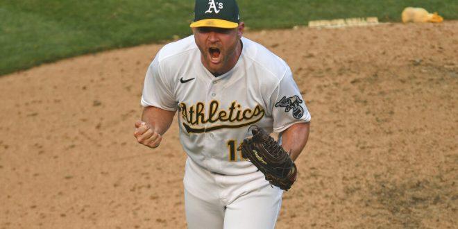 A's pitcher Liam Hendriks celebrates strikeout