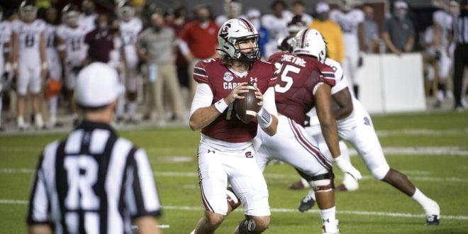 South Carolina quarterback drops to pass