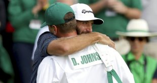 Dustin Johnson hugs brother