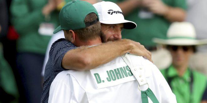 Dustin Johnson hugs brother