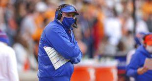 Dan Mullen coaching on sidelines