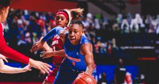 Gator women's basketball player dribbles