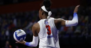 T'ara Ceasar serving in Saturday's Gators Volleyball match against Arkansas