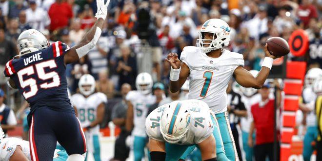 Miami Dolphins quarterback throws ball