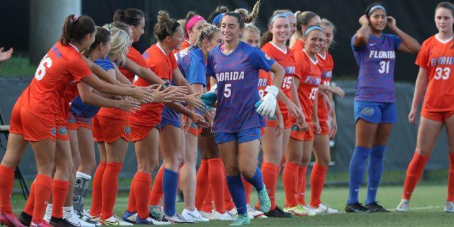 Gators soccer high-five down sideline